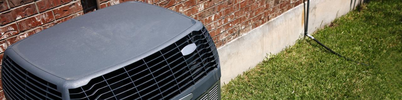 outdoor HVAC unit on green grass