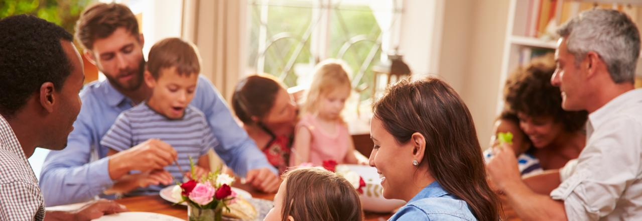 happy family eating a meal in home dining room